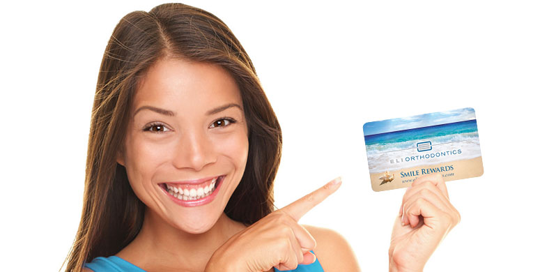 woman holding rewards card